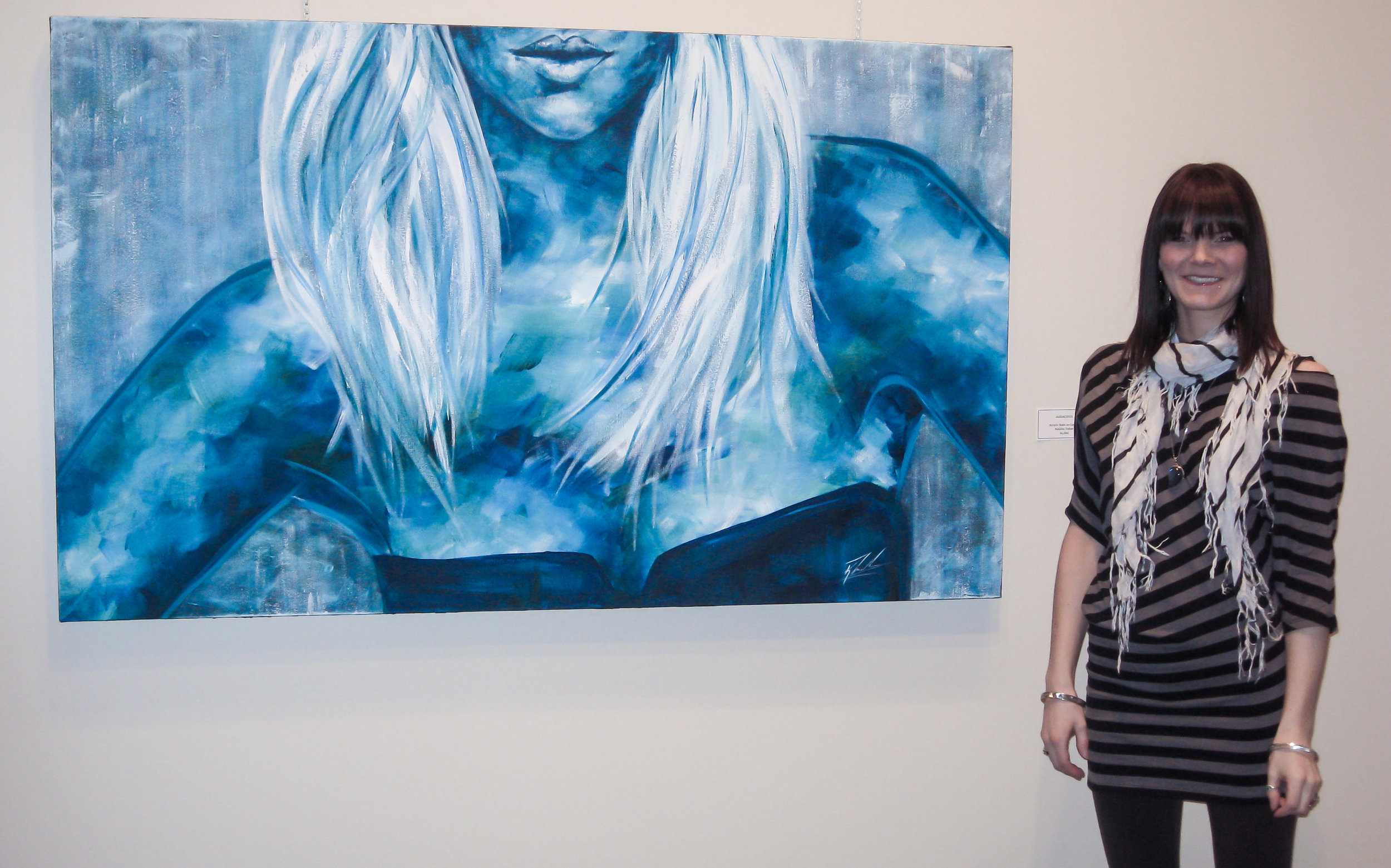 me beside one of my artworks at my solo show opening at the Centre for the arts in Kimberley bc.jpg