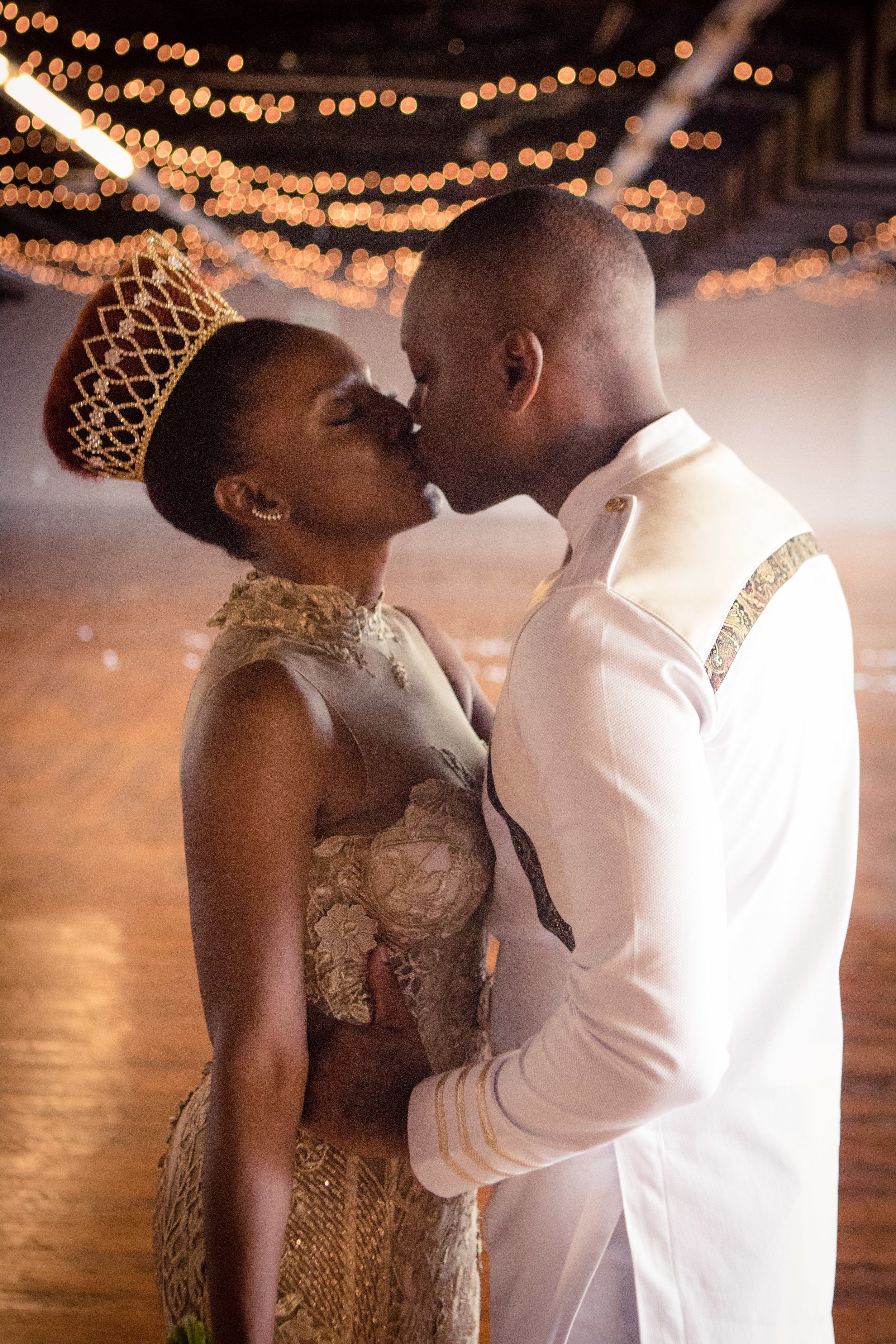 Designer: Tabitha Fielteau & Groom (groom's outfit by  Threaded Culture )