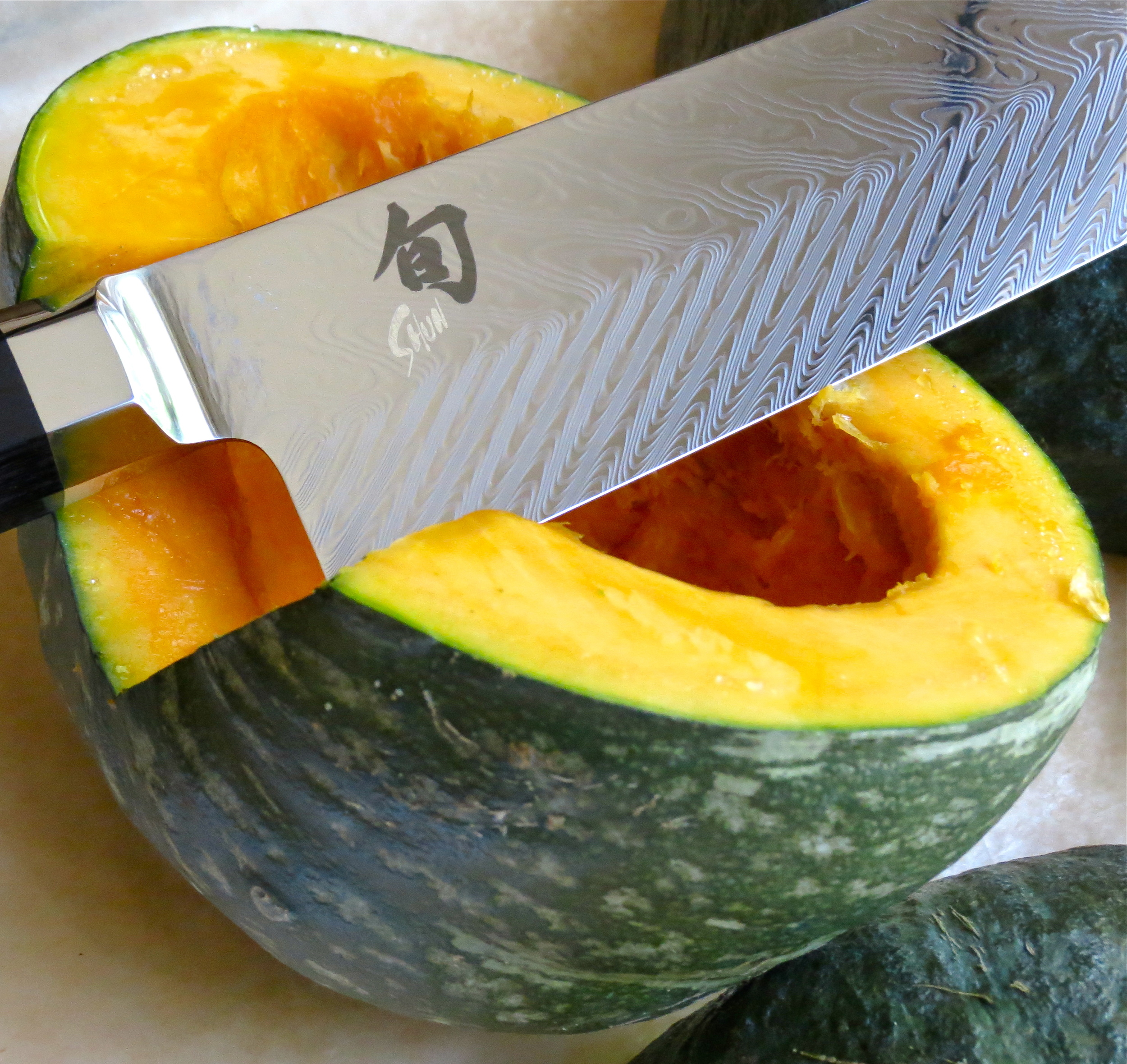 Use a good quality, sharp knife, like thus  Shun , to cut the squash in half.