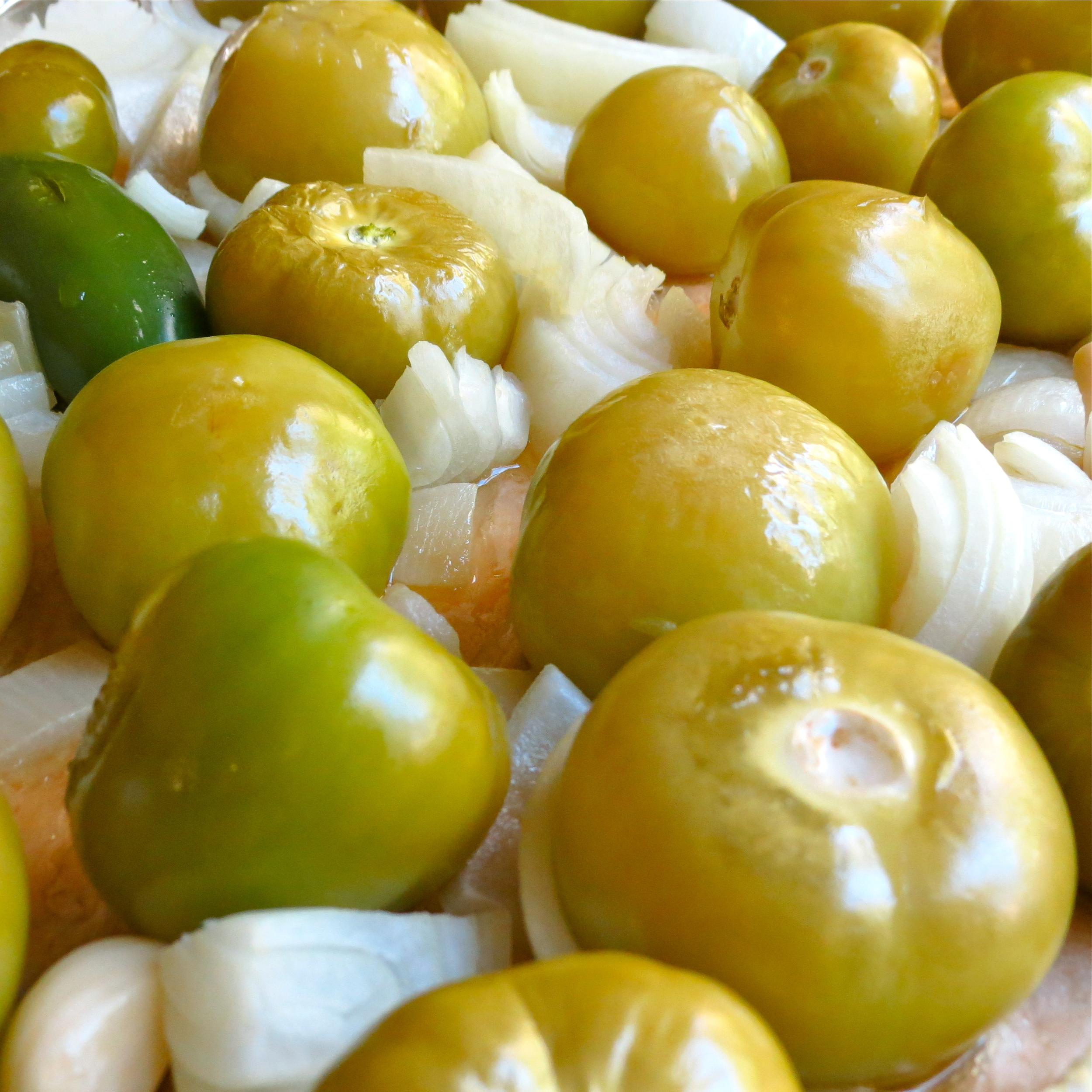 Roasted tomatillos are tender with light brown spots.