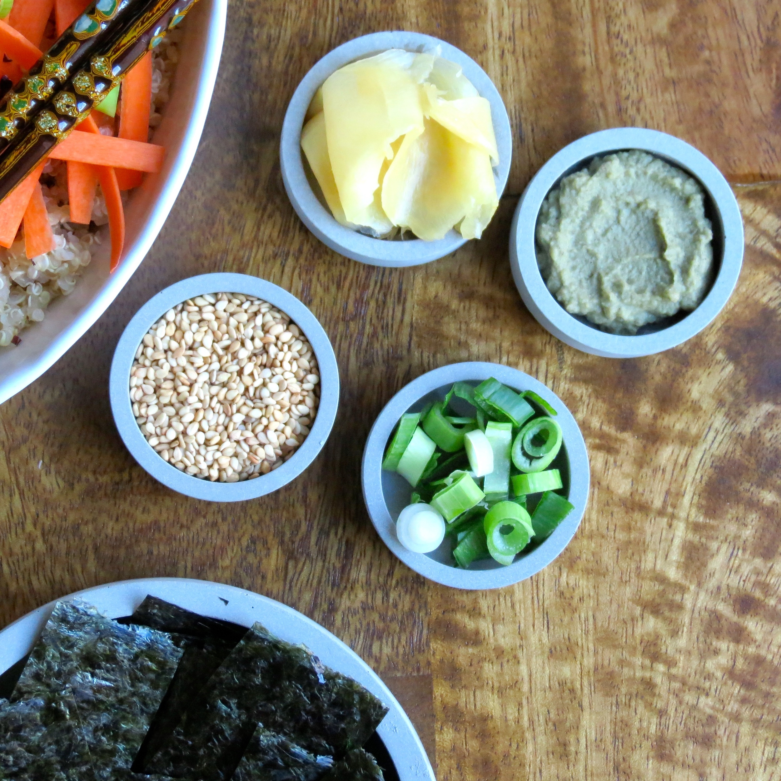 Ginger, wasabi, green onions, and nori strips make excellent companions to this bowl.