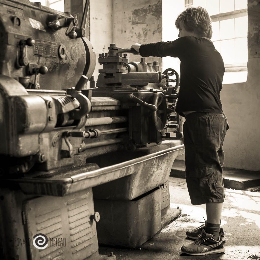 Cyan Metcalf shows us how his grandfather Murray Metcalf used the lathe at Cockatoo Island, Sydney © Leonard Metcalf 2014