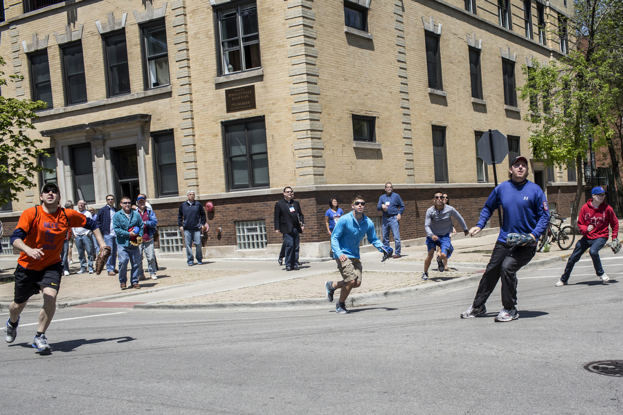 Fans shag balls during batting practice on Waveland Avenue. Dave Davison, second to the right, has collected more than 5000 balls in more than 20 years.