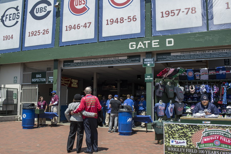 Bora Bora Bill and Mae Merrill embrace as they look inside Wrigley Field.