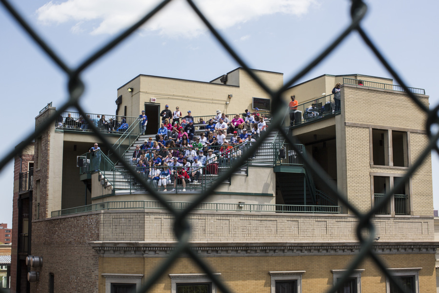 Fans watch the game from the rooftop bleachers on Sheffield Avenue.