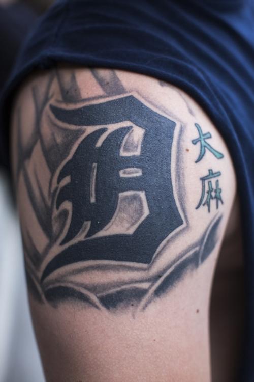 Derek Johnson shows off his tattoos.