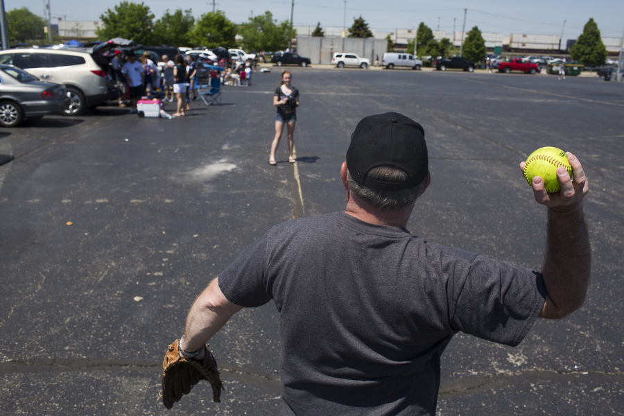 Brian Bonchick plays catch with his daughter Amanda before the game.
