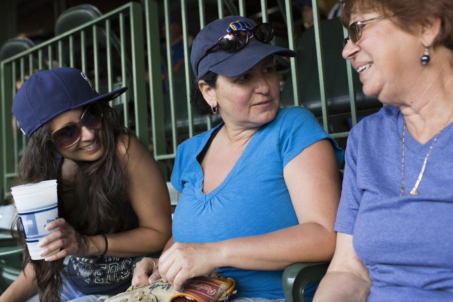 Three generations of Brewers fans: From left, Mayra, Estela and Natalie. Their husbands all left the game early.