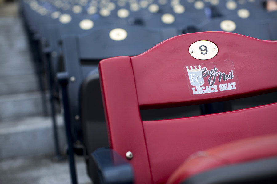 """This is the Buck O'Neil Legacy Seat. It's impossible for me to give Mr. O'Neil a proper introduction in just a caption but the short of the story is that he played and managed for the Kansas City Monarchs, one of the most successful negro league baseball teams of all time. After the league folded, he became a highly respected scout and ambassador of the game. He also was integral in establishing the Negro Leagues Baseball Museum. Mr. O'Neilpassed away in 2006 and to keep his memory alive, the Royals have designated his seat for """" member of the community who, on a large or small scale, embodies an aspect of O'Neil's spirit."""" It is the only red seat in the stadium."""