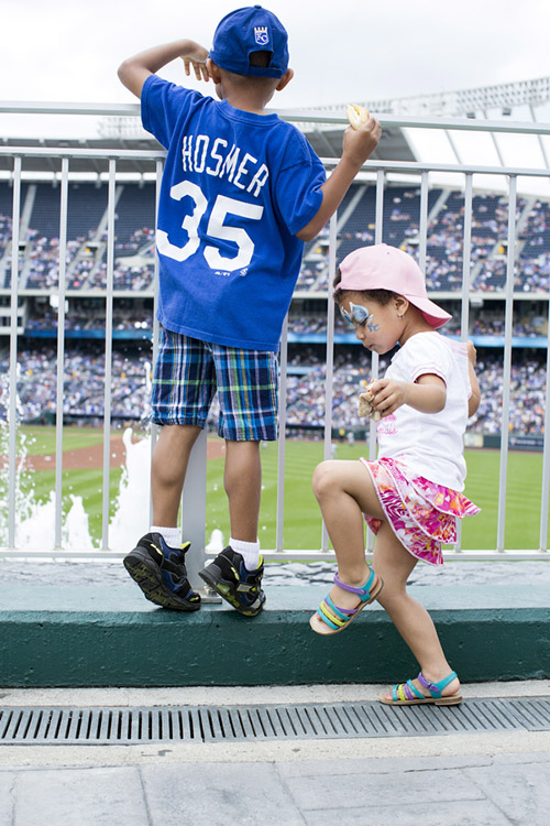 Thomas, 6, and Sophia Smith, 3, enjoy the outfield concourse before the game.