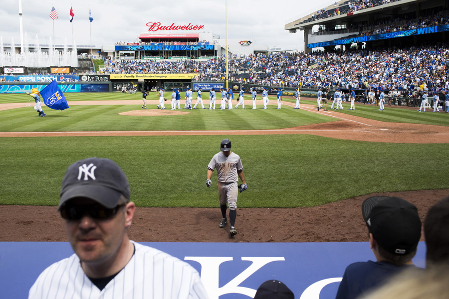 OutfieldBrett Gardner walks off the field after striking out to end the game as the Royals high-five on the field.