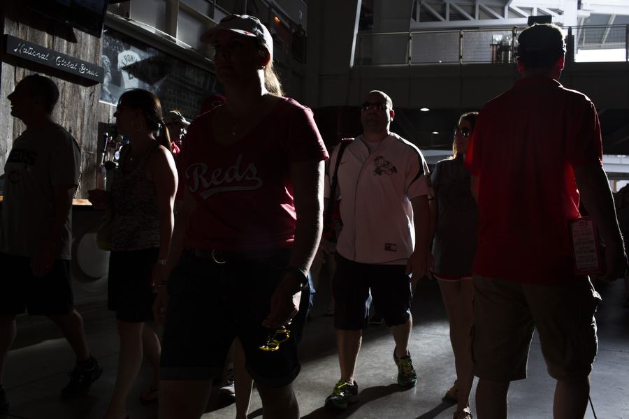 Fans walk on the 100 level concourse.