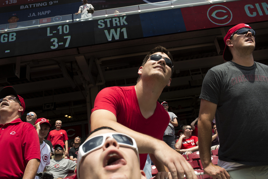 Fans look up as a batting practice home run enters the bleachers.