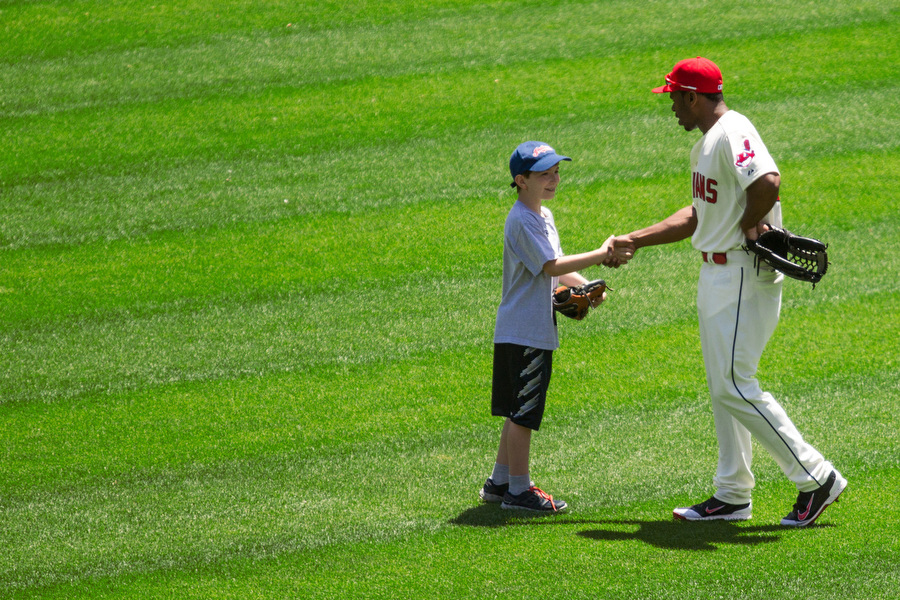Right before the game, Indians centerfielder Michael Bourn met a student who participated in the High Achievers Kids Club program.