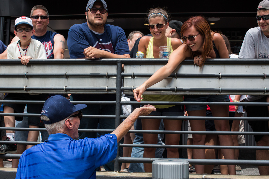 """Usher Richard collects aluminum beer can tops from fans during the game. He collects hundreds of them per game and then donates them to the Aluminum Cans for Burned Children Foundation. """"I've been collecting tickets and everyone's situated so now I'm starting to collect can tops,"""" he said."""