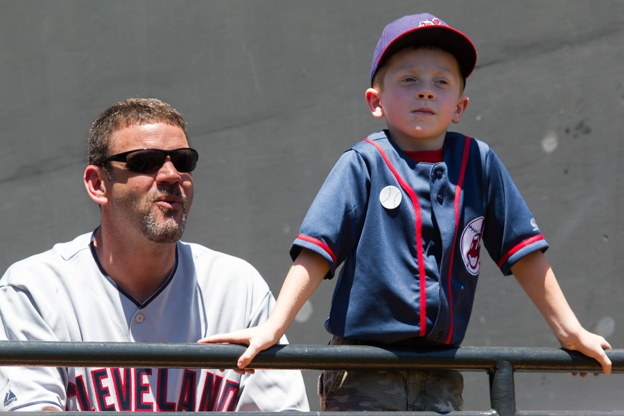 Rich Holland and his five-year-old son Nick look onto the field before the game.