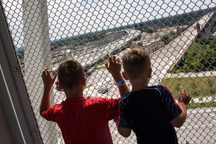 From left, Adrian and Jackson look out onto the street from the upper deck of the stadium.