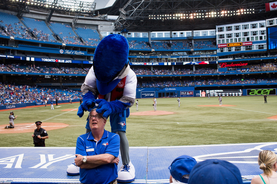 Ace the Toronto Blue Jays mascot jokes around with an usher.