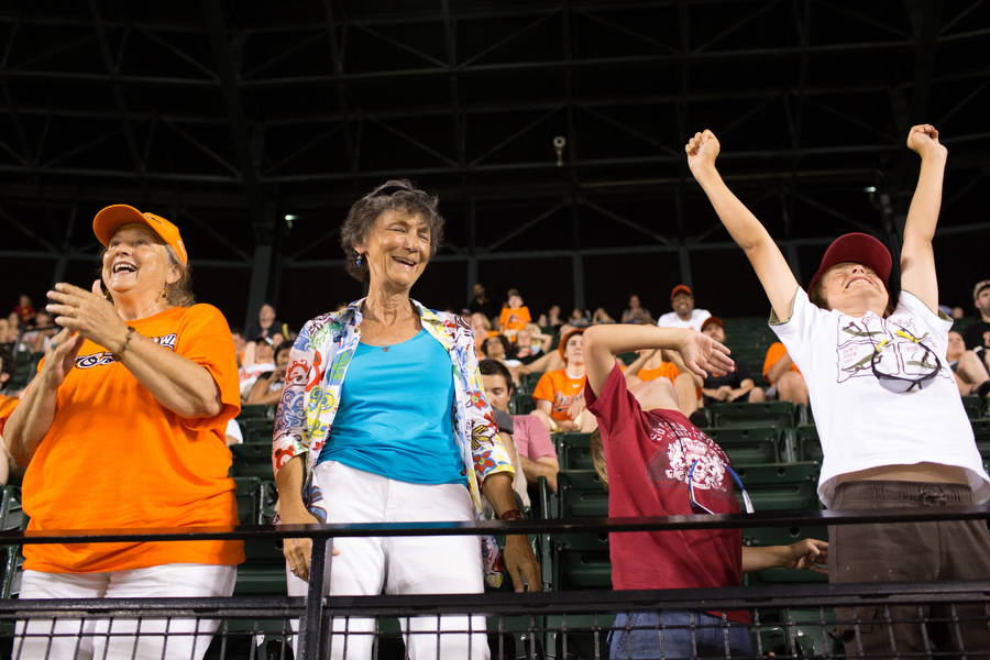 From left, Linda Sprenkle, Marcia Talley, Joseph and Thomas cheer during a pitching change.