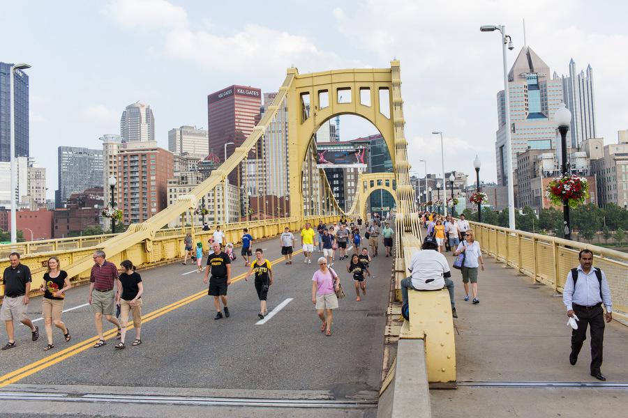 Fans walk over the Roberto Clemente Bridge towards PNC Park.