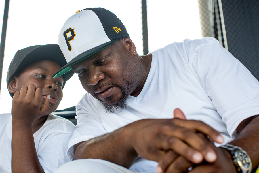 Monty and his son Amari talk during the game.