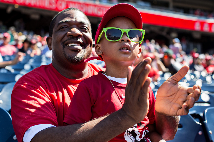 Seymour Clarke took his 3-year-old son Shemari to his first game.