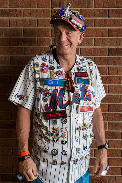 """Nick Giampietro, known better as """"Pin Man,"""" wears a jersey with more than 100 pins on it whenever he goes to a game. He has season tickets and comes to almost every Mets home game. He works in a deli as his daytime job."""