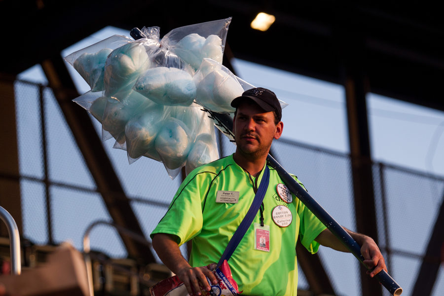 Vendor Peter Tehomillic sells cotton candy and cracker jacks in the upper deck.