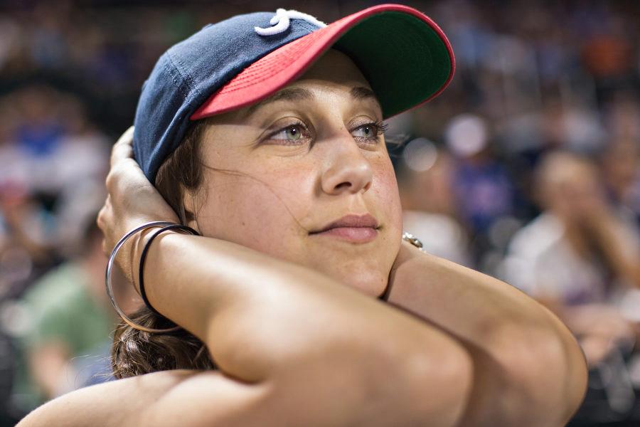 Braves fan Sara looks on as the Mets threaten to score.