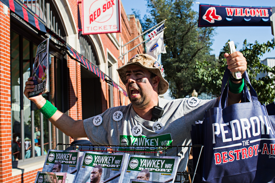 Sly sells Yawkey Way Report before the game.