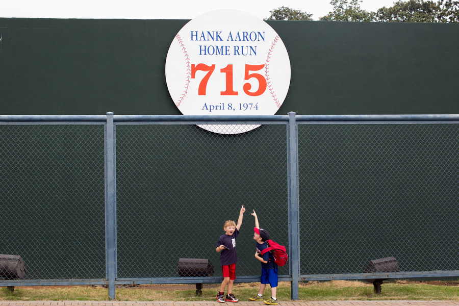 The section of the fence from the Braves' old stadium where Hank Aaron hit his 715th home run to surpass Babe Ruth for most career home runs still stands next door to Turner Field.
