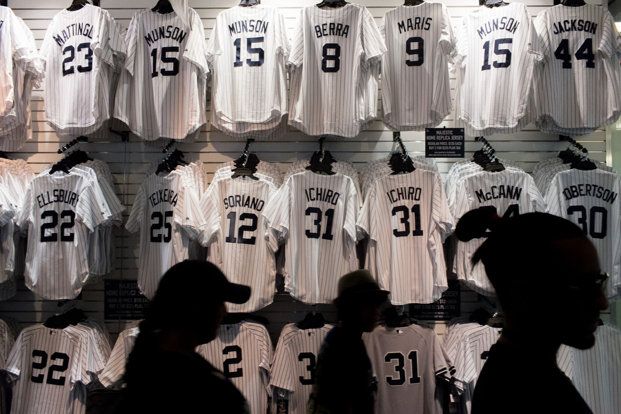 A merchandise store on the lower level concourse sells Yankee jerseys from players of different eras.