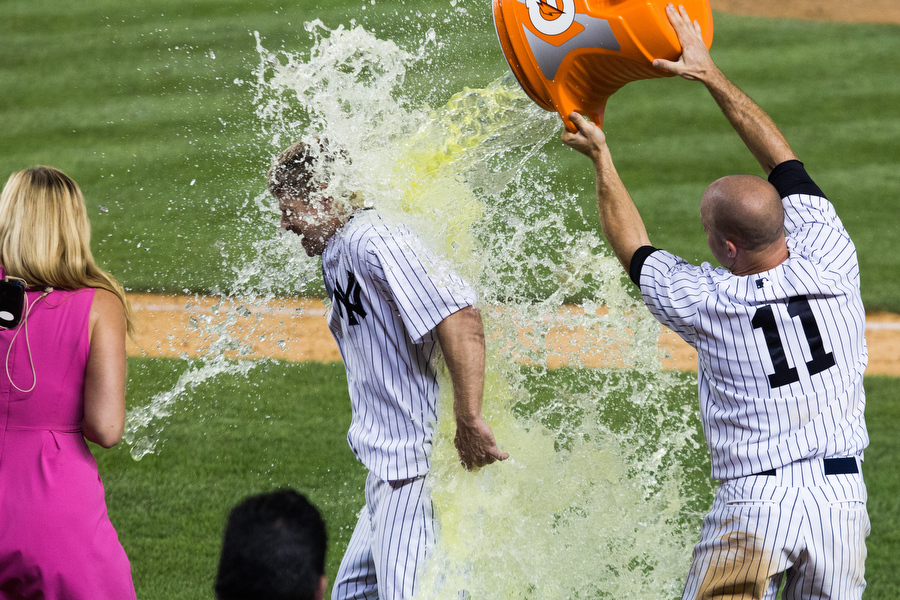 Chase Headley gets doused in Gatorade after hitting a walk-off single to defeat the Rangers in the 14th inning.
