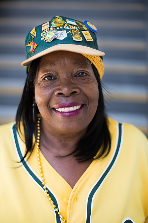 """Evelyn Smith has been coming to games since 1972. She says that any day she is alive and gets to see a baseball game is a great day. All the players are her """"sons,"""" even opposing players."""