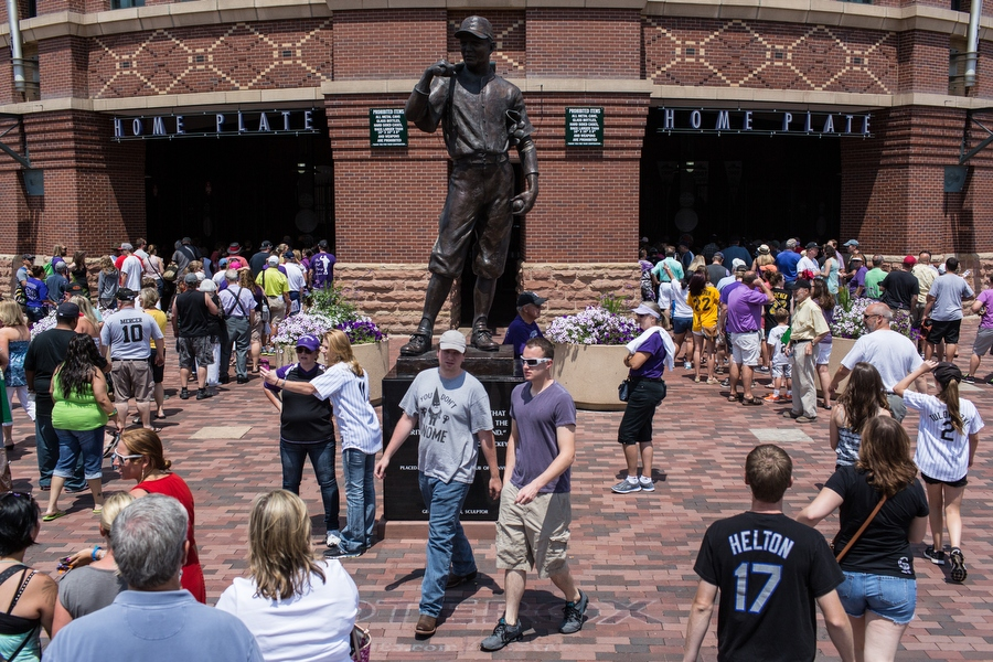 """A statue of Branch Rickey stands in front of the Coors Field home plate entrance. A quote inscribed on the statue reads, """"It is not honor that you take with you but the heritage you leave behind."""""""