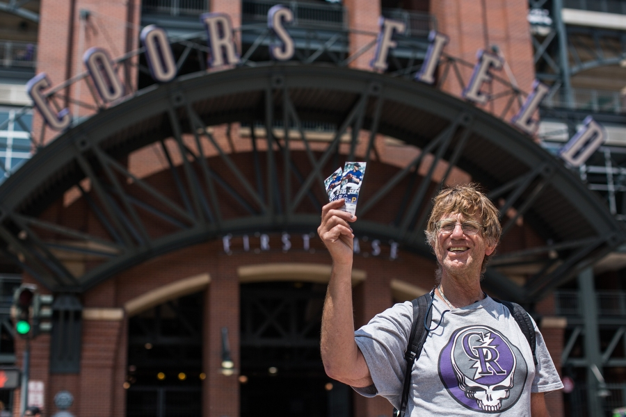 """Gary is a long-time ticket scalper who also designed the shirt he wore to the game. His sales pitch for selling the very good seats he was holding up: """"Who wants to see the Rockies lose up close?"""" He said he loves the Rockies, but in rough years like this, """"you've got to keep it light."""""""