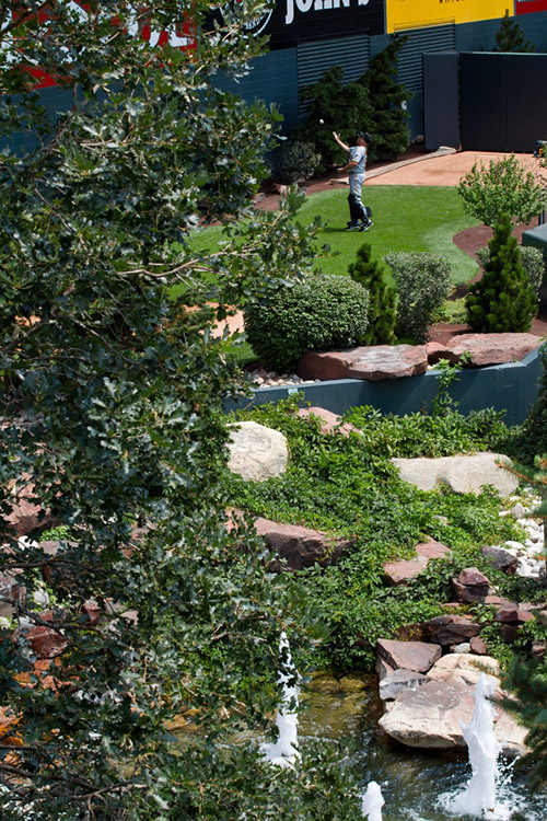 The waterfall, fountains, rocks and pine trees just past the center field wall are an homage to the open space in Colorado.