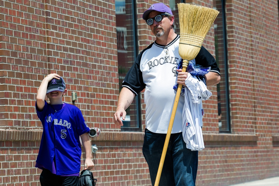 Doug and his grandson Caleb head to a restaurant before the game. Doug carried a broom because if the Rockies won on Sunday, they would sweep the visiting Pittsburgh Pirates.