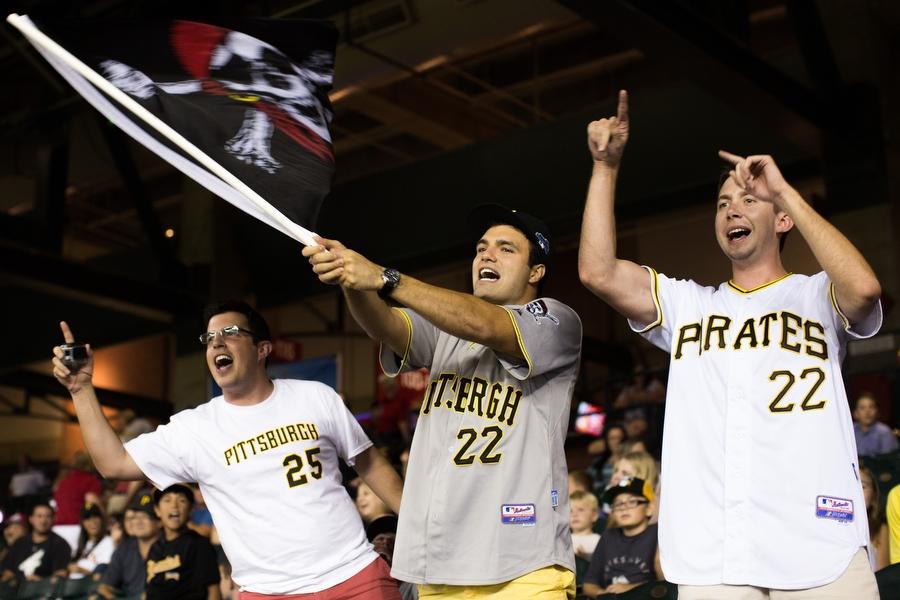 From left, Michael,Nick andMatt cheer on the Pirates.