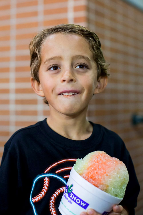 Asher, 7, ordered shaved ice at the game.