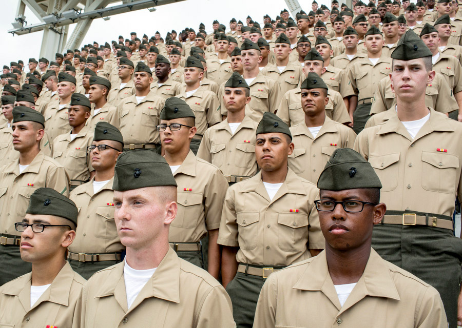 Recruits and graduates of the Marine Corps Recruit Depot in San Diego stand at attention before the game. At each home Sunday game, the Padres honor members of the military.