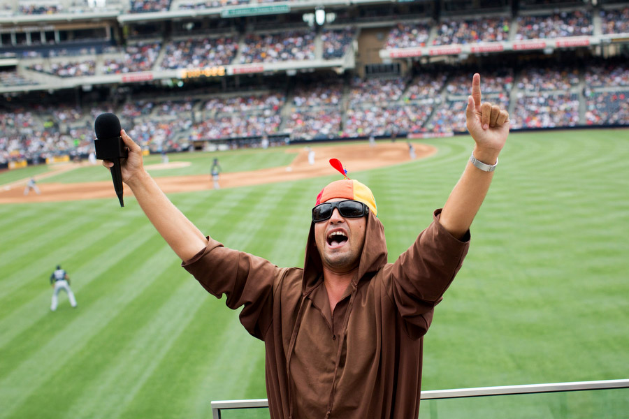 Friar Blue encourages fans to cheer in the right field bleachers. The Friar is the team mascot and a small group of fans in the bleachers dress up as friars each game.