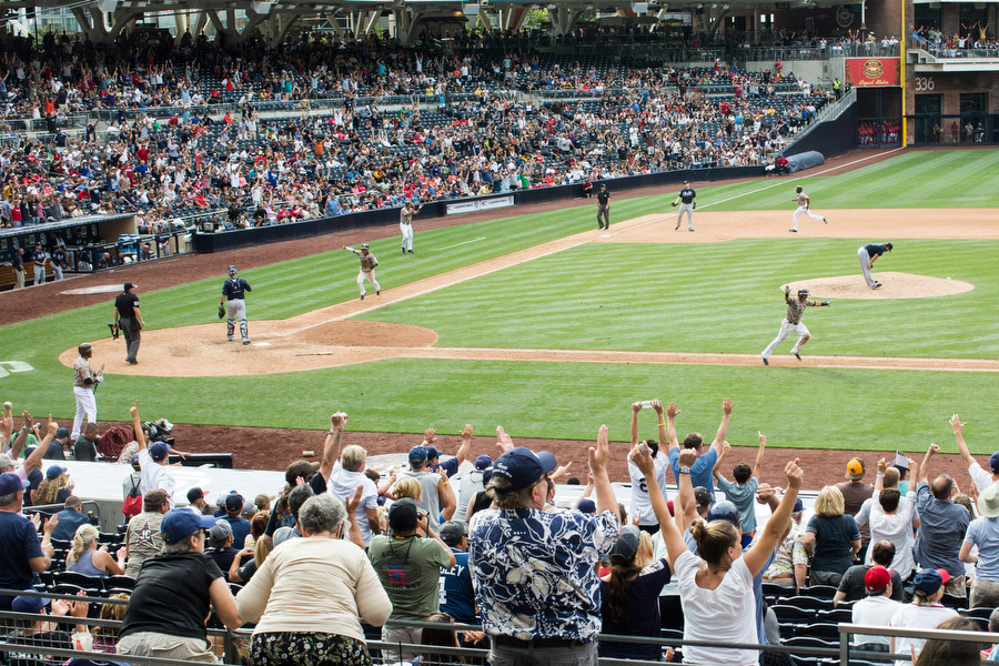 Shortstop Everth Cabrera raises his hands after hitting the game-winning single in the 10th inning to beat the Braves.