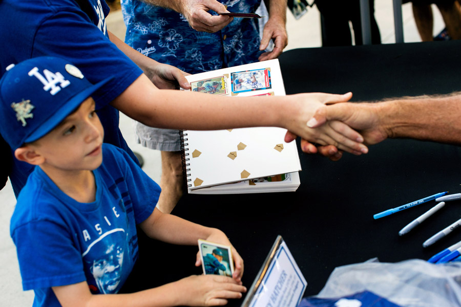 Fans meet former Dodgers catcher Mickey Hatcher during an autograph signing session.