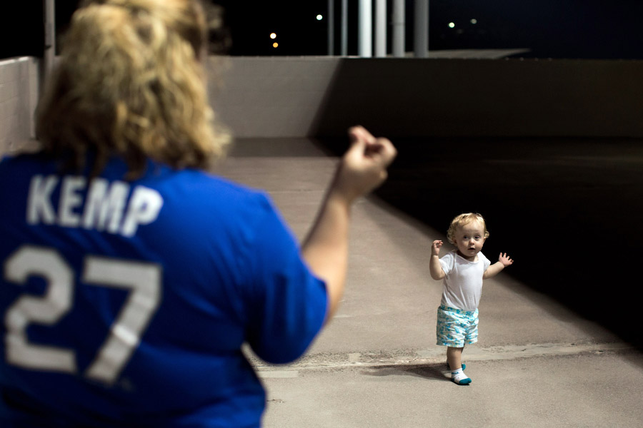 Rachelle and her daughter Isabella, 1, spend time away from the game on the outfield concourse. It was Isabella's first game.