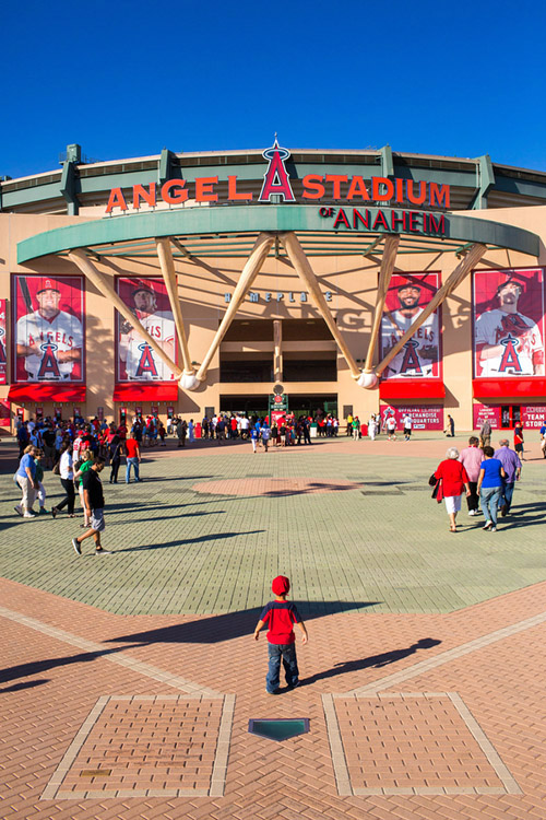 The home plate gate entrance at Angels Stadium features a full-size brick infield and pitcher's mound.