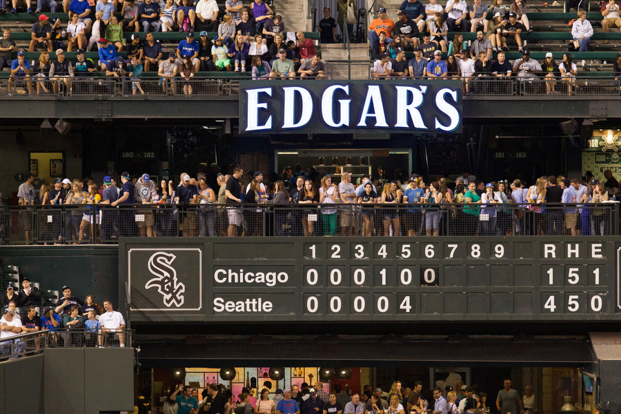 The scoreboard in left field is operated by hand, an homage to the century-old ballparks.