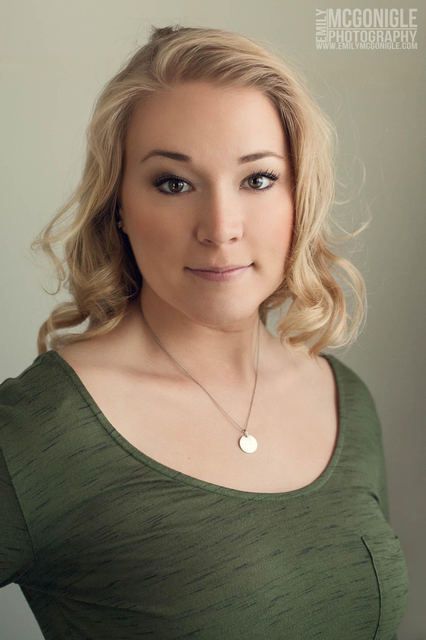 portrait of blond woman wearing green top