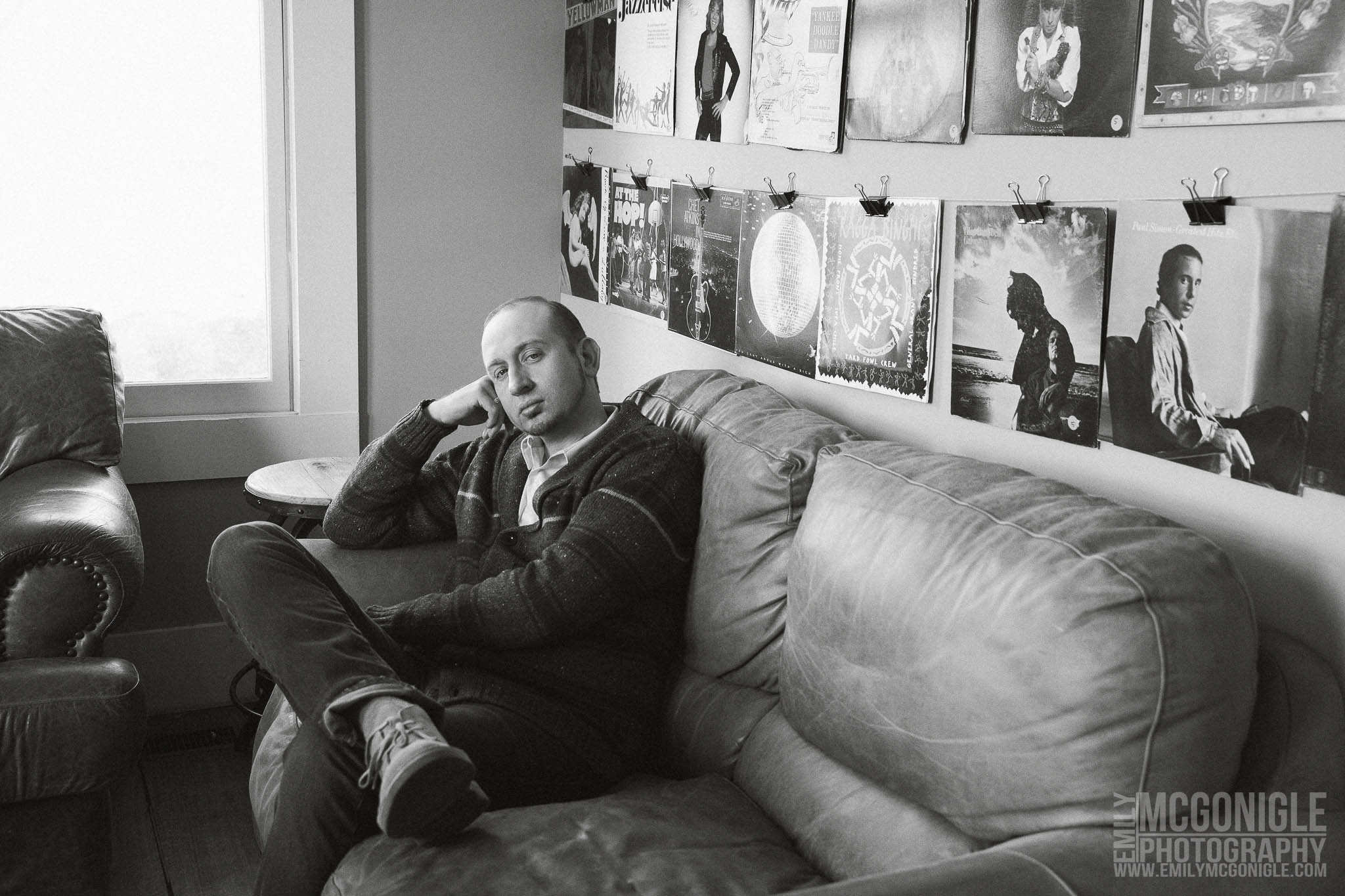 black and white portrait on a couch in front of vinyl