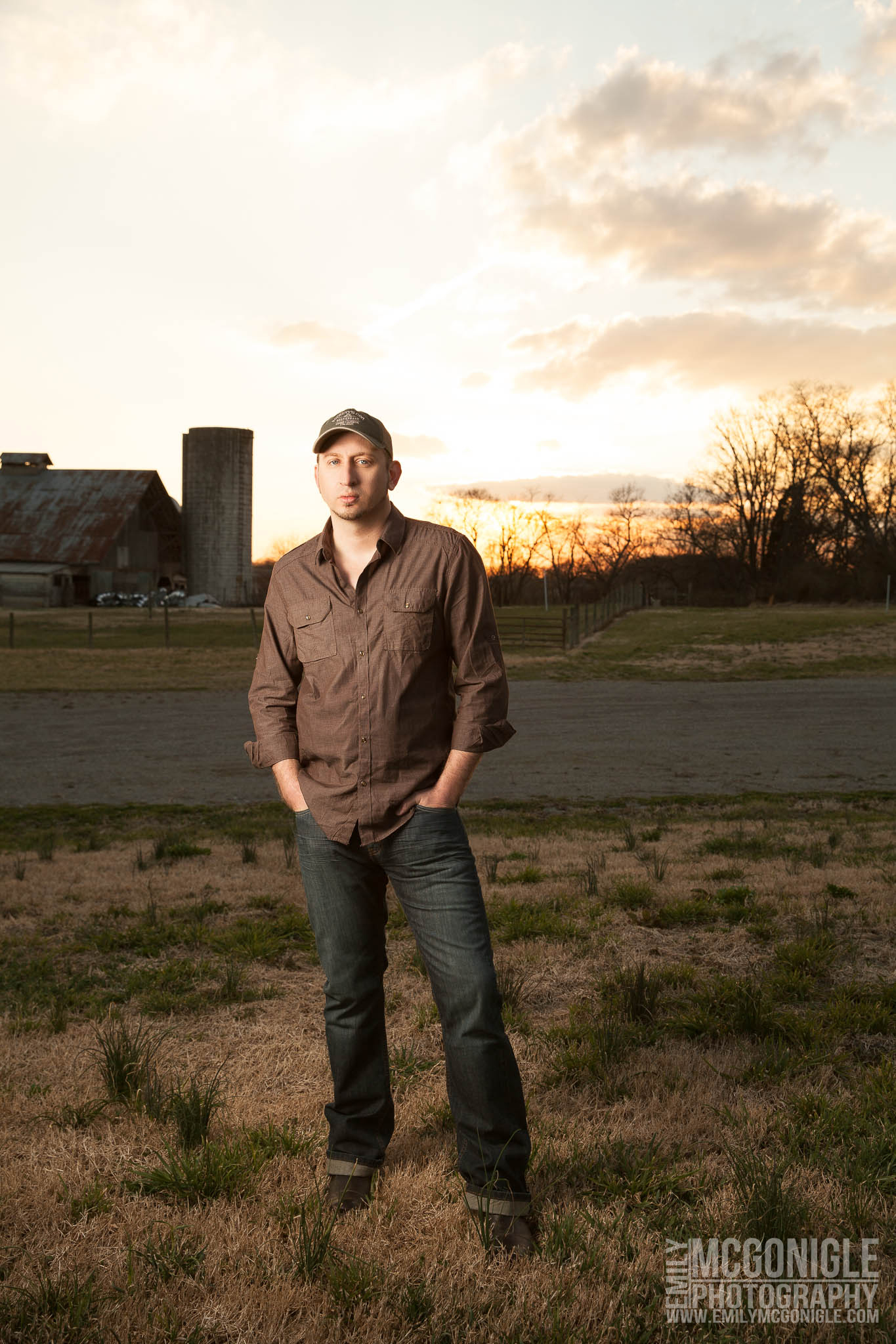 portrait in a farm field at sunset